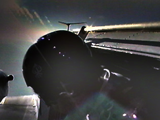 Exiting a Twin Otter, 2000. From video by Reno Ross.